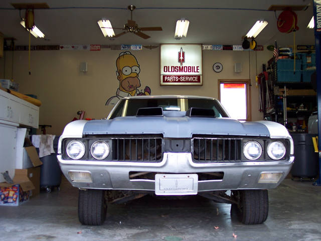 1969 Oldsmobile Cutlass removing all the glass for a complete restoration.
